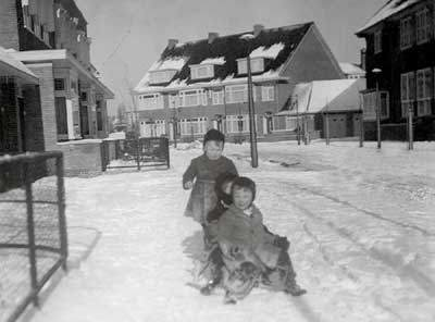 Steven Frank (front), a friend and Carel Frank (rear) on sledge outside their house. Amsterdam 1941.