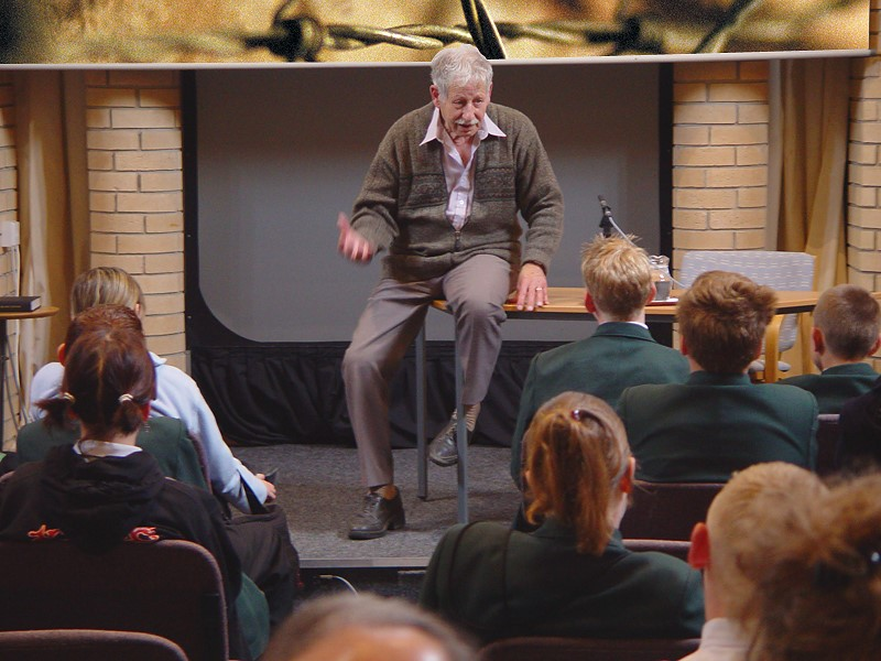 Man talking to a group of students