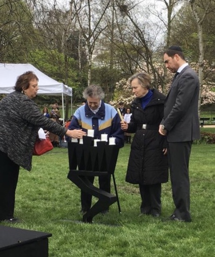 People lighting candles for Yom HaShoah 2018, Hyde Park, London